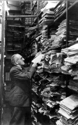 man in paper archives